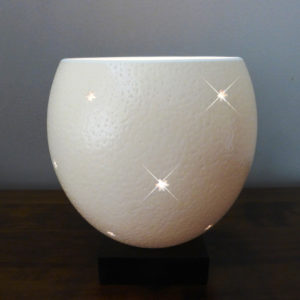 Image of an Ostrich Egg Tealight (Large) with pattern of Small Stars