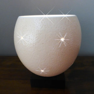 Hand carved Ostrich Egg tealight, featuring a pattern of carved Big Stars