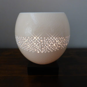Hand carved Ostrich Egg tealight with a pattern inspired by the Milky Way