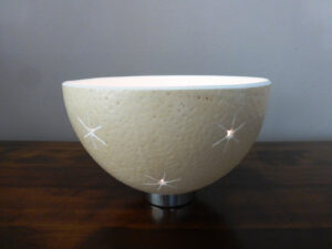 Stunning Ostrich Egg tealight holder. Hand carved and featuring a pattern of large stars